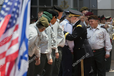 Chairman of the United States Joint Chiefs of Staff Gen Martin E Dempsey (2 R) Escorted by Israeli Chief of Staff Lieutenant General Gadi Eizenkot (r) Embraces an Unidentified Israeli Military Officer As He Goes Down the Line Greeting Old Friends in the Israeli Military During a Ceremony in the Israeli Military Headquarters in Tel Aviv Israel 09 June 2015 Honoring Dempsey's Tenure As the Usa's Leading Military Officer As His Term Comes to a Close Dempsey Said There was No Country in the World Standing So Firmly Behind Israel Israel Tel Aviv