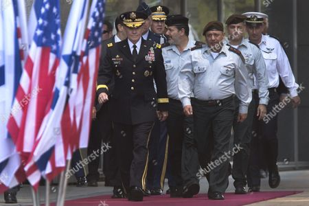 Chairman of the United States Joint Chiefs of Staff Gen Martin E Dempsey (l) Escorted by Israeli Chief of Staff Lieutenant General Gadi Eizenkot (c R) and Other Officers Pass Flags As They Arrive to a Ceremony in the Israeli Military Headquarters in Tel Aviv Israel 09 June 2015 Honoring Dempsey's Tenure As the Usa's Leading Military Officer As His Term Comes to a Close Dempsey Said There was No Country in the World Standing So Firmly Behind Israel Israel Tel Aviv