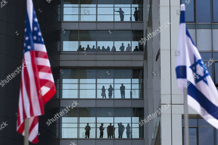 Us and Israeli Flags Fly As Workers Inside the Israeli Military Headquarters Watch Proceedings During a Ceremony Honoring Visiting Chairman of the United States Joint Chiefs of Staff Gen Martin E Dempsey at the Israeli Military Headquarters in Tel Aviv Israel 09 June 2015 Dempsey's Tenure As the Usa's Leading Military Officer is Coming to a Close and He was Honored by Israel and Awarded a Medal Israel Tel Aviv