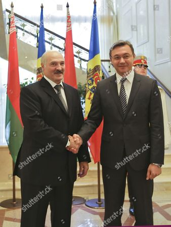 Belarus President Alexander Lukashenko (l) Shake Hands with the President of Moldova's Parliament Igor Corman (r) at the State Residence During the Second Day of His Official Visit in Chisinau Moldova 25 September 2104 Lukashenko is Scheduled to Meet with Prime Minister Iurie Leanca and the Leaders of the Parliamentary Fractions Moldova, Republic of Chisinau