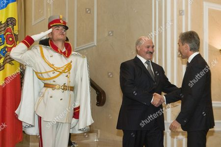 The Belarus President Alexander Lukashenko (c) is Welcomed by the Prime Minister of Moldova Iurie Leanca (r) at State Residence During His Two-day Official Visit in Chisinau Moldova on 25 September 2104 Moldova, Republic of Chisinau