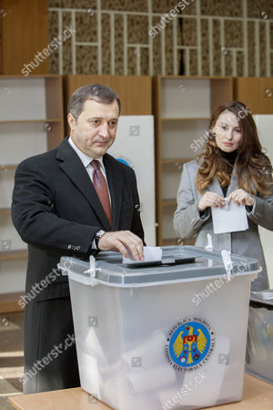The Head of Liberal Democratic Party Vladimir Filat (l) with His Wife Angela Gonta (r) Cast Their Ballot at a Polling Station During Parliamentary Elections in Chisinau Moldova 30 November 2014 Polls Opened in Moldova For Parliamentary Elections That Many Say Will Decide the Tiny Country's Future Foreign Policy Course Campaigning Focused on Whether the Landlocked Country Wedged Between Romania and Ukraine Should Align with Russia Or the West Moldova, Republic of Chisinau