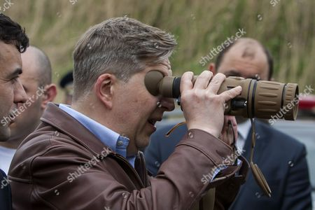 Stock Photo of Pirkka Tapiola the Head of the Eu Delegation to Moldova Looks Trought the Ir Binocular at Crossing Point Border Moldova-romania (ue) in Leuseni 104 Km Est From Chisinau Moldova on 28 April 2015 the Visit at Border Crossing Point Called Leuseni-albita Marks the First Anniversary of the Abolition of Visa Regime with the Eu For Moldovan Citizens Holders of Biometric Passports According to Data For One Year Through Checkpoints Located on the Border with Romania and Chisinau International Airport Were Recorded Over 460 000 Moldovan Citizens Crossing Into the Schengen Area Moldova, Republic of Chisinau