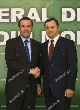 Manfred Weber (l) the Leader of the European People's Party (epp) in the European Parliament Shakes Hands with the Head of Liberal Democratic Party of Moldova Vladimir Filat (r) During His Visit in Moldova on 25 July 2014 Moldova, Republic of Chisinau