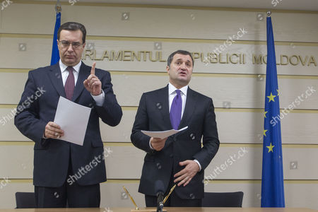 The Head of the Democratic Party of Moldova Marian Lupu (l) with Head of the Liberal-democratic Party Vladimir Filat (r) Gestures After Signing the Coalition Agreement For the Political Alliance For European Moldova the Successor of Pro-european Government in the Parliament of Moldova in Chisinau Moldova on 23 January 2015 Moldova, Republic of Chisinau