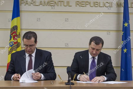 Stock Picture of The Head of the Democratic Party of Moldova Marian Lupu (l) with Head of the Liberal-democratic Party Vladimir Filat (r) Sign the Coalition Agreement For the Political Alliance For European Moldova the Successor of Pro-european Government in the Parliament of Moldova in Chisinau Moldova on 23 January 2015 Moldova, Republic of Chisinau