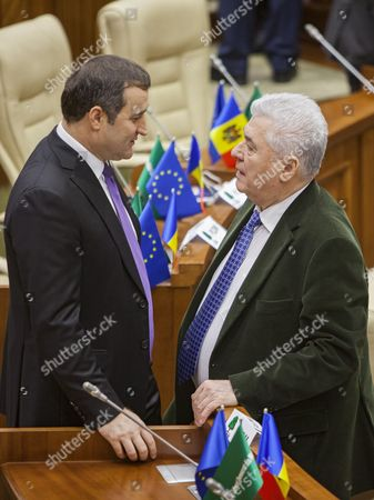 The Head of Liberal Democratic Party Vladimir Filat (l) Talks with Head of Communist Party Vladimir Voronin (r) in the New Parliament of Moldova Which was Elected on 30 November 2014 As It Meets For Its First Constitutive Session at the Parliament Building in Chisinau Moldova 29 December 2014 Three Pro-european Parties Had Won a Narrow Majority in Moldova's Parliamentary Elections Gaining Together 44 Per Cent Or 54 Seats in the of 101-strong Parliament Moldova, Republic of Chisinau