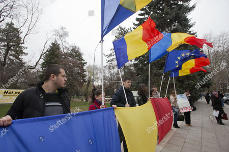 People Wave Flags to Welcome the Former President of Romania Traian Basescu (not Pictured) During His Visit in Chisinau Moldova 02 April 2015 Moldova, Republic of Chisinau