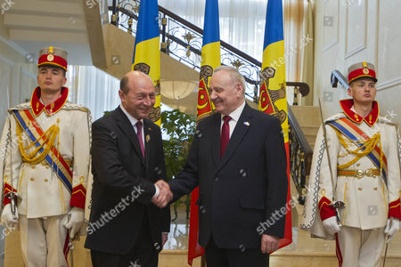 Former President of Romania Traian Basescu (l) Shakes Hand with President of Moldova Nicolae Timofti (r) During Their Meeting in Chisinau Moldova 02 April 2015 Basescu was Decorated by the President of Moldova Nicolae Timofti with the Order of 'Stefan Ce Mare' Moldova, Republic of Chisinau