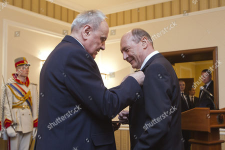 President of Moldova Nicolae Timofti (l) Decorates the Former President of Romania Traian Basescu (r) with the Order of 'Stefan Ce Mare' During His Visit in Chisinau Moldova 02 April 2015 Moldova, Republic of Chisinau