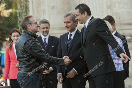 Prime Minister of Romania Victor Ponta (r) with His Moldova's Counterpart Iurie Leanca (c) Shake Hands with Director of Theatre 'Eugene Ionesco' Petru Vutcarau (l) During the Donation of 100 Buses For Schools Three Buses For Theaters and 35 Cars For Public Institutions in the Great National Assembly Square in Chisinau Moldova 10 October2014 Moldova, Republic of Ungheni
