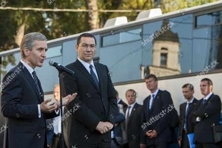 Prime Minister of Moldova Iurie Leanca (l) with His Romanian Counterpart Victor Ponta (r) Give a Speech During the Donation of 100 Buses For Schools Three Buses For Theaters and 35 Cars For Public Institutions in the Great National Assembly Square in Chisinau Moldova 10 October2014 Moldova, Republic of Ungheni
