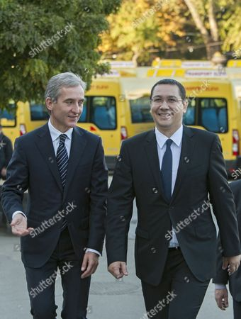 Prime Minister of Romania Victor Ponta (r) with His Moldova's Counterpart Iurie Leanca (l) Arrive During the Donation of 100 Buses For Schools Three Buses For Theaters and 35 Cars For Public Institutions in the Great National Assembly Square in Chisinau Moldova 10 October2014 Moldova, Republic of Ungheni