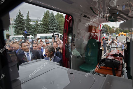 The Prime Minister of Romania Victor Ponta (l) with His Moldova's Counterpart Iurie Leanca (c) Look Inside the Car During Donation of the Five Special Cars For Smurd (emergency Mobile Service For Resuscitation and Extrication) in Ungheni City 114 Km North-west From Chisinau Moldova 27 August 2014 Moldova, Republic of Ungheni