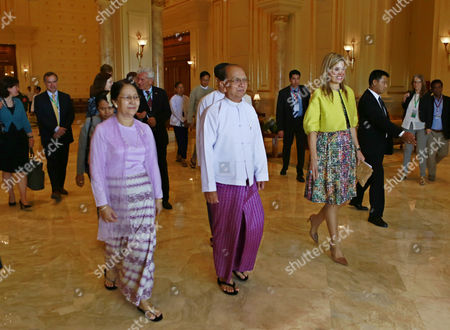 Myanmar President Thein Sein (c) His Wife Khin Khin Win (c-l) and Dutch Queen Maxima (c-r) the Un Secretary-general's Special Advocate For Inclusive Finance For Developmen (unsgsa) Walk As They Leave the Meeting Room at the President's Resident Office in the Capital Naypyitaw Myanmar 01 April 2015 Queen Maxima is on an Official Visit at the Invitation of the Government of Myanmar Myanmar Naypyitaw