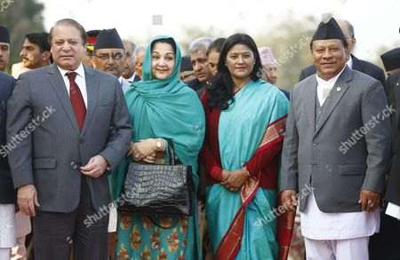 Nepalese Deputy Prime Minister Prakash Man Singh (r) and His Wife Srijana (2-r) Welcome Pakistani Prime Minister Nawaz Sharif (l) and Pakistani First Lady Begum Kalsoom Nawaz (2-l) As They Arrive at Kathmandu Airport Nepal 25 November 2014 the 18th South Asian Association For Regional Cooperation Summit is Scheduled From 26 to 27 November 2014 in Kathmandu Heads of State From Nepal India Pakistan Bangladesh Sri Lanka Bhutan Afghanistan and Maldives Will Attend the Main Summit Nepal Kathmandu