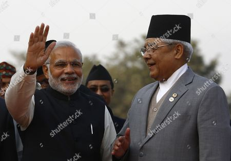 Nepalese Deputy Prime Minister Bamdev Gautam (r) Welcomes Indian Prime Minister Narendra Modi As He Arrives at Kathmandu Airport Nepal 25 November 2014 the 18th South Asian Association For Regional Cooperation Summit is Scheduled From 26 to 27 November 2014 in Kathmandu Heads of State From Nepal India Pakistan Bangladesh Sri Lanka Bhutan Afghanistan and Maldives Will Attend the Main Summit Nepal Kathmandu
