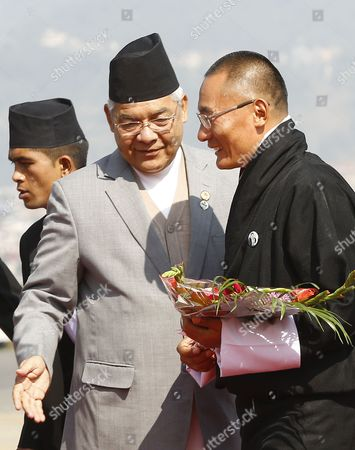 Stock Picture of Nepalese Deputy Prime Minister Bamdev Gautam (l) Welcomes Prime Minister of the Kingdom of Bhutan Lyonchhen Tshering Tobgay (r) As He Arrives at Kathmandu Airport Nepal 25 November 2014 the 18th South Asian Association For Regional Cooperation Summit is Scheduled From 26 to 27 November 2014 in Kathmandu Heads of State From Nepal India Pakistan Bangladesh Sri Lanka Bhutan Afghanistan and Maldives Will Attend the Main Summit Nepal Kathmandu
