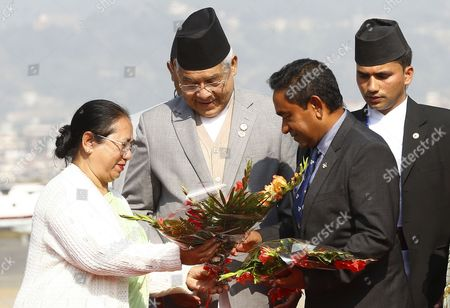 Nepalese Deputy Prime Minister Bamdev Gautam (c) Welcomes Maldives President Abdulla Yameen (r) As He Arrives at Kathmandu Airport Nepal 25 November 2014 the 18th South Asian Association For Regional Cooperation Summit is Scheduled From 26 to 27 November 2014 in Kathmandu Heads of State From Nepal India Pakistan Bangladesh Sri Lanka Bhutan Afghanistan and Maldives Will Attend the Main Summit Nepal Kathmandu