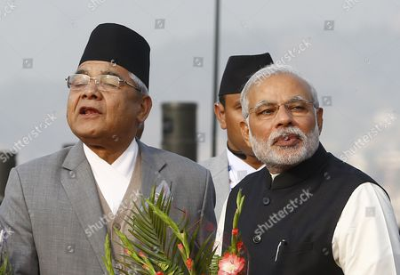 Stock Photo of Nepalese Deputy Prime Minister Bamdev Gautam (l) Welcomes Indian Prime Minister Narendra Modi As He Arrives at Kathmandu Airport Nepal 25 November 2014 the 18th South Asian Association For Regional Cooperation Summit is Scheduled From 26 to 27 November 2014 in Kathmandu Heads of State From Nepal India Pakistan Bangladesh Sri Lanka Bhutan Afghanistan and Maldives Will Attend the Main Summit Nepal Kathmandu