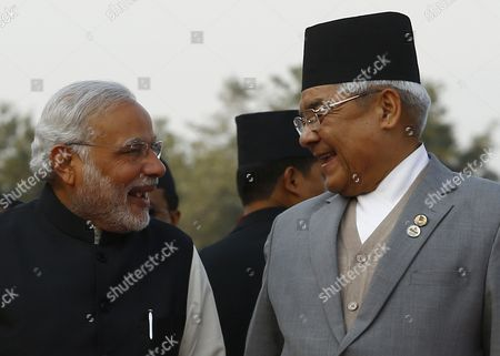 Stock Image of Nepalese Deputy Prime Minister Bamdev Gautam (r) Welcomes Indian Prime Minister Narendra Modi As He Arrives at Kathmandu Airport Nepal 25 November 2014 the 18th South Asian Association For Regional Cooperation Summit is Scheduled From 26 to 27 November 2014 in Kathmandu Heads of State From Nepal India Pakistan Bangladesh Sri Lanka Bhutan Afghanistan and Maldives Will Attend the Main Summit Nepal Kathmandu