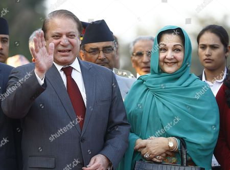 Pakistani Prime Minister Nawaz Sharif (l) and Pakistani First Lady Begum Kalsoom Nawaz (r) Arrive at Kathmandu Airport Nepal 25 November 2014 the 18th South Asian Association For Regional Cooperation Summit is Scheduled From 26 to 27 November 2014 in Kathmandu Heads of State From Nepal India Pakistan Bangladesh Sri Lanka Bhutan Afghanistan and Maldives Will Attend the Main Summit Nepal Kathmandu