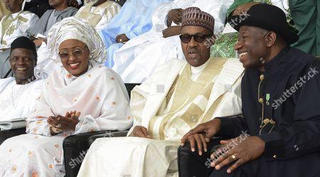 Nigerian President Muhammadu Buhari (2-r) Sits with Outgoing President Goodluck Jonathan (r) Vice President-elect Yemi Osinbajo (l) and Aisha Buhari the New First Lady of Nigeria (2-l) During His Inauguration in Abuja Nigeria 29 May 2015 Muhammadu Buhari was Inuagurated As President of Nigeria at a Ceremony in the Capital Abuja Nigeria Abuja