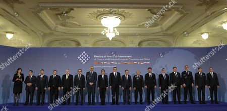Family Photo Taken During the China -cee (central and East European Countries) Summit at the Parliament Palace in Bucharest Romania 26 November 2013 the Meeting of the Heads of Government in Central and Eastern Europe - China was Attended by Prime Ministers of Albania Bosnia-herzegovina Bulgaria Czech Republic Croatia Estonia Lithuania Macedonia Montenegro Poland Serbia Slovakia Slovenia Hungary and Latvia in Order to Boost Trade and Investment Relations Between the Two Areas in Common Projects Regarding the Sectors of Energy Agriculture Infrastructure Transport It and Tourism From Left to Right the Participants Could Be Identiefied As Prime Ministers Of: Slovenia -alenka Bratusek Serbia - Ivica Dacic Macedonia - Nikola Gruevski Hungary - Viktor Orban Czech Republic - Jiri Rusnok Bulgaria - Plamen Oresharski Albania - Edi Rama China - Li-keqiang Romania- Victor Ponta Poland - Donald Tusk Bosnia Herzegovina - Vjeroslav Bevanda Croatia - Zoran Milanovic Estonia - Andrus Ansip Lithuania - Algirdas Butkevicius Montenegro - Milo Djukanovic Slovakia - Robert Fico and Latvia Foreign Minister Edgars Rinkevics Romania Bucharest