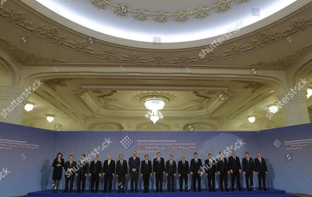 Stock Picture of Family Photo Taken During the China -cee (central and East European Countries) Summit at the Parliament Palace in Bucharest Romania 26 November 2013 the Meeting of the Heads of Government in Central and Eastern Europe - China was Attended by Prime Ministers of Albania Bosnia-herzegovina Bulgaria Czech Republic Croatia Estonia Lithuania Macedonia Montenegro Poland Serbia Slovakia Slovenia Hungary and Latvia in Order to Boost Trade and Investment Relations Between the Two Areas in Common Projects Regarding the Sectors of Energy Agriculture Infrastructure Transport It and Tourism From Left to Right the Participants Could Be Identiefied As Prime Ministers Of: Slovenia -alenka Bratusek Serbia - Ivica Dacic Macedonia - Nikola Gruevski Hungary - Viktor Orban Czech Republic - Jiri Rusnok Bulgaria - Plamen Oresharski Albania - Edi Rama China - Li-keqiang Romania- Victor Ponta Poland - Donald Tusk Bosnia Herzegovina - Vjeroslav Bevanda Croatia - Zoran Milanovic Estonia - Andrus Ansip Lithuania - Algirdas Butkevicius Montenegro - Milo Djukanovic Slovakia - Robert Fico and Latvia Foreign Minister Edgars Rinkevics Romania Bucharest