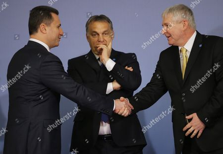Stock Image of Hungarian Prime Minister Viktor Orban (c) Looks on As His Counterparts From Macedonia Nicola Gruevski (l) and Czech Republic Jiri Rusnok (r) Shakes Hands During the Family Photo Session of the China -cee (central and East European Countries) Summit at the Parliament Palace in Bucharest Romania 26 November 2013 the Meeting of the Heads of Government in Central and Eastern Europe - China was Attended by Prime Ministers of Albania Bosnia-herzegovina Bulgaria Czech Republic Croatia Estonia Lithuania Macedonia Montenegro Poland Serbia Slovakia Slovenia Hungary and Latvia in Order to Boost Trade and Investment Relations Between the Two Areas in Common Projects Regarding the Sectors of Energy Agriculture Infrastructure Transport It and Tourism Romania Bucharest