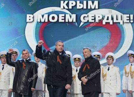 Stock Photo of Crimean Leaders Premier of the Crimean Government Sergey Aksionov (c) Speaker of the Supreme Council of Crimea Vladimir Konstantinov (l) and Head of Sevastopol City Administration Alexei Chaliy (r) Attend a Rally Celebrating Crimea and Sevastopol Joining Russia on Red Square in Moscow Russia 18 March 2014 Crimea and Sevastopol Will Join Russia As Two Separate Regions President Putin Said Adding That He Would Sign Treaties Immediately Russian Federation Moscow