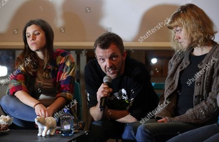 Stock Photo of Greenpeace International Activists Camila Speziale (l) of Argentina Philip Ball (c) of the United Kingdom and Sini Saarela (r) of Finland Attend a Meeting with Residents of St Petersburg Russia 23 December 2013 Russian Federation St. Petersburg