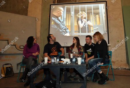 Stock Image of (l-r) Greenpeace International Activists Faiza Oulahsen of the Netherlands Dima Litvinov of Sweden Camila Speziale of Argentina Philip Ball of the United Kingdom and Sini Saarela of Finland Attend a Meeting with Residents of St Petersburg Russia 23 December 2013 Russian Federation St. Petersburg
