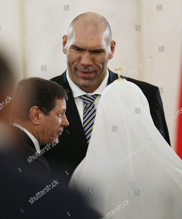 Former Russian Boxer Nikolai Valuev Dwarfs Two Other Guests As He Awaits the Annual President Vladimir Putin Address to the Federal Assembly in the Grand Kremlin Palace in Moscow Russia 12 December 2013 Russian Federation Mosocw