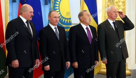 Stock Photo of Russian President Vladimir Putin (second From Left) ) Kazakhstan's President Nursultan Nazarbayev (2nd-r) Belarus President Alexander Lukashenko (l) and Ukrainian Prime Minister Nikolai Azarov (r) Pose For Pictures During the Supreme Eurasian Economic Council in Moscow Russia 24 December 2013 Nikolai Azarov Arrived in Moscow to Develop Economic Cooperation with Russia and Other Countries of the Customs Union Despite Sharp Negative Reaction of Pro-european Opposition Russian Federation Moscow