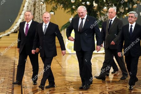 Stock Image of Russian President Vladimir Putin (2nd-l) Kazakhstan's President Nursultan Nazarbayev (l) Belarus President Alexander Lukashenko (c) Ukrainian Prime Minister Nikolai Azarov (2nd-r) and Armenian Presidents Serj Sargsyan (r) Enter a Hall For Family Picture During the Supreme Eurasian Economic Council in Moscow Kremlin Russia 24 December 2013 Nikolai Azarov Arrived in Moscow to Develop Economic Cooperation with Russia and Other Countries of the Customs Union Despite Sharp Negative Reaction of Pro-european Opposition Russian Federation Moscow