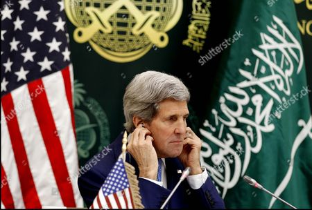 Us Secretary of State John Kerry Adjusts His Ear Piece During a Press Conference with Saudi Arabia Foreign Minister Prince Saud Al-faisal (not Pictured) in Riyadh Saudi Arabia 05 March 2015 Media Reports State Kerry is Visiting Saudi Arabia to Reassure Jittery Arab Gulf Nations Arguing That Washington is Still Keen to Contain Iran's Regional Influence and Prevent It From Acquiring Nuclear Weapons According to Kerry a Safer Gulf Region 'Begins by Preventing [iran] From Having a Nuclear Weapon ' in Addition the Us Will not Turn a Blind Eye to Iran's 'Destabilizing' Influence in Countries Like Syria Iraq and Yemen He Said Saudi Arabia Riyadh