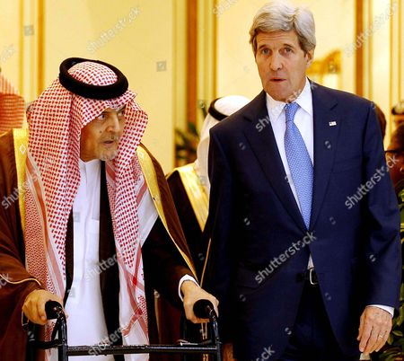 Us Secretary of State John Kerry (r) Walks with Saudi Arabia Foreign Minister Prince Saud Al-faisal (l) in Riyadh Saudi Arabia 05 March 2015 Media Reports State Kerry is Visiting Saudi Arabia to Reassure Jittery Arab Gulf Nations Arguing That Washington is Still Keen to Contain Iran's Regional Influence and Prevent It From Acquiring Nuclear Weapons According to Kerry a Safer Gulf Region 'Begins by Preventing [iran] From Having a Nuclear Weapon ' in Addition the Us Will not Turn a Blind Eye to Iran's 'Destabilizing' Influence in Countries Like Syria Iraq and Yemen He Said Saudi Arabia Riyadh