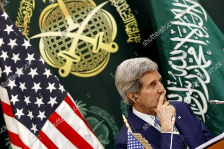 Us Secretary of State John Kerry Listens During a Press Conference with Saudi Arabia Foreign Minister Prince Saud Al-faisal (not Pictured) in Riyadh Saudi Arabia 05 March 2015 Media Reports State Kerry is Visiting Saudi Arabia to Reassure Jittery Arab Gulf Nations Arguing That Washington is Still Keen to Contain Iran's Regional Influence and Prevent It From Acquiring Nuclear Weapons According to Kerry a Safer Gulf Region 'Begins by Preventing [iran] From Having a Nuclear Weapon ' in Addition the Us Will not Turn a Blind Eye to Iran's 'Destabilizing' Influence in Countries Like Syria Iraq and Yemen He Said Saudi Arabia Riyadh