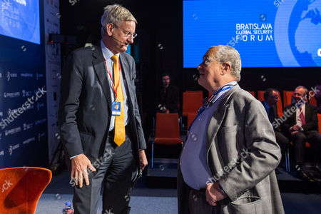 Stock Photo of Swedish Foreign Minister Carl Bildt (l) Talks with Czech Foreign Minister Karel Schwarzenberg Prior to the Session Titled 'Snowed Under: Balancing out Security and Privacy' at the 2014 Globsec Security Forum in Bratislava Slovakia 14 May 2014 Slovakia (slovak Republic) Bratislava