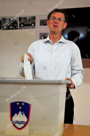 Miro Cerar President of the Smc (miro Cerar Party) Casts His Ballot at a Polling Station in Ljubljana Slovenia 13 July 2014 Slovenians on 13 July Vote in Snap Parliamentary Elections That is Coming Just As the Country Begins to Show Signs of Tentative Recovery From Its Economic and Financial Crisis Only 30 Months After the Country's Last Snap Polls the Vote is Once Again Unlikely to Produce a Clear-cut Winner with Enough Clout to Rein in the Runaway Spending That Has Brought It to the Verge of Having to Seek a Eu Bailout This Election was Forced when Outgoing Prime Minister Alenka Bratusek Lost a Power Struggle Within Her Positive Slovenia Party (ps) Slovenia Ljubljana