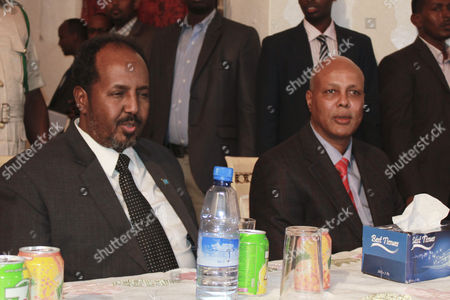 Somalia's President Hassan Sheikh Mohamud (l) Sits Next to the Newly-appointed Prime Minister Abdiweli Sheikh Ahmed (r) During a Nomination Ceremony at the Presidential Palace in Mogadishu Somalia 12 December 2013 Somalia's President Hassan Sheikh Mohamud Appointed a Somali-canadian Economist Abdiweli Sheikh Ahmed As His New Prime Minister on 12 December to Replace Abdi Farah Shirdon who was Forced out by Lthe Country's Awmakers in Early December 2013 Somalia Mogadishu