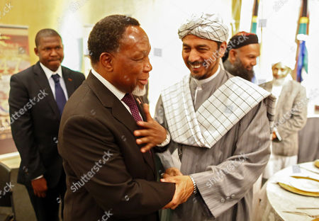 Stock Image of South African Deputy President Kgalema Motlanthe (l) is Greeted by Imam Ebrahim Gabriels (r) During a Graduation Ceremony of Muslim Religious Leaders As Marriage Officers in Cape Town South Africa 30 April 2014 Since Muslims Were First Brought to South Africa As Slaves More Than Three Centuries Ago Their Marriages Had No Legal Standing Before Today's Graduation Ceremony Now For the First Time in South African History Muslim Marriages Will Be Recognised More Than One Hundred Muslim Clerics Or Imams Graduated As Marriage Officers in the Pilot Project by the Department of Home Affairs Marking a Historic Day in South Africa's Young Democracy South Africa is to Hold General Elections on 07 May 2014 Twenty Years Since the End of Apartheid South Africa Cape Town
