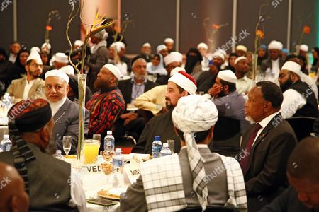 Stock Picture of South African Deputy President Kgalema Motlanthe (r) Listens to Speeches During a Graduation Ceremony of Muslim Religious Leaders As Marriage Officers in Cape Town South Africa 30 April 2014 Since Muslims Were First Brought to South Africa As Slaves More Than Three Centuries Ago Their Marriages Had No Legal Standing Before Today's Graduation Ceremony Now For the First Time in South African History Muslim Marriages Will Be Recognised More Than One Hundred Muslim Clerics Or Imams Graduated As Marriage Officers in the Pilot Project by the Department of Home Affairs Marking a Historic Day in South Africa's Young Democracy South Africa is to Hold General Elections on 07 May 2014 Twenty Years Since the End of Apartheid South Africa Cape Town