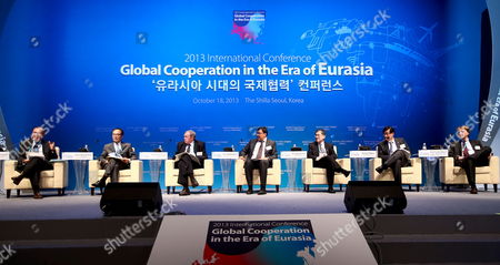 Stock Image of (l-r) Supachai Panitchpakdi Former Director-general of Wto and Former Secretary-general of Unctad Joon-kyung Kim President of Korea Development Institute Honorable Donals Johnston Former Secretary -general of Oecd Aziz Abdukhakimov Chairman of the State Committee of Uzbekistan of Privatization Demonopolization and Competition Development Kyonglim Choi Deputy Minister Ministry of Trade Industry and Energy Kyttack Hong Chairman and Ceo of Kdb Financial Group and Kora Development Bank and Timofey Bordachev Deputy-dean of the National Research University Higher School Fo Economics Speak About 'Cooperation in Trade and Development in the Era of Eurasia' During a Session of the 2013 International Conference of Global Cooperation in the Era of Eurasia in Seoul South Korea 18 October 2013 Korea, Republic of Seoul