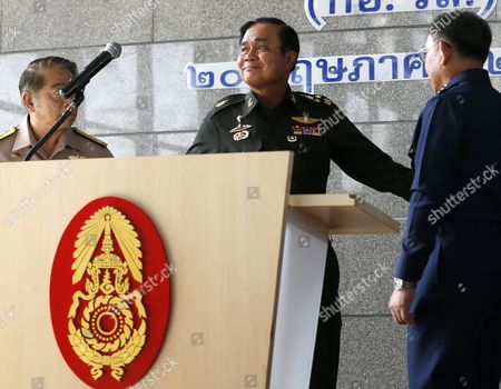 Thai Army Chief General Prayut Chan-o-cha (c) Leaves the Press Conference Next to Navy Chief Adm Narong Pipattanasai (l) Air Chief Marshall Prachin Chantong (r) at the Army Club in Bangkok Thailand 20 May 2014 Thai Army Chief Prayut Chan-o-cha Early on 20 May 2014 Declared Martial Law Giving the Military Full Control to Prevent Further Protest-related Violence in the Country the Statement was Issued About 3 Am on 20 May (2000 Gmt) According to Local Media Reports Prayuth Has the Authority to Declare Martial Law Without the Consent of the Government Which Has Had Caretaker Status Since 09 December 2013 Thailand Has Been Wracked by Six Months of Non-stop Protests Seeking to Topple the Government at Least 25 People Have Died in Political-related Violence and More Than 700 Injured Thailand Bangkok