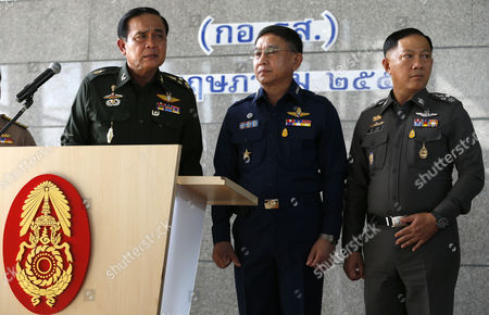 Thai Army Chief General Prayut Chan-o-cha (l) Listens to a Media Question Next to Air Chief Marshall Prachin Chantong (c) and Police Chief Adul Saengsingkaew (r) During a Press Conference at the Army Club in Bangkok Thailand 20 May 2014 Thai Army Chief Prayut Chan-o-cha Early on 20 May 2014 Declared Martial Law Giving the Military Full Control to Prevent Further Protest-related Violence in the Country the Statement was Issued About 3 Am on 20 May (2000 Gmt) According to Local Media Reports Prayuth Has the Authority to Declare Martial Law Without the Consent of the Government Which Has Had Caretaker Status Since 09 December 2013 Thailand Has Been Wracked by Six Months of Non-stop Protests Seeking to Topple the Government at Least 25 People Have Died in Political-related Violence and More Than 700 Injured Thailand Bangkok