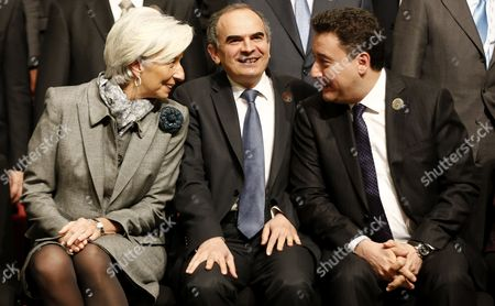 Managing Director of the International Monetary Fund (imf) Christine Lagarde (l) Deputy Prime Minister of Turkey Ali Babacan (r) and Turkey's Central Bank Governer Erdem Basci (c) As They Prepare to Pose For a Family Photo During the G20 Meeting of Finance Ministers and Central Bank Governors at the Finance Ministry in Istanbul Turkey 10 February 2015 Turkey Istanbul
