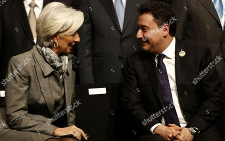 Managing Director of the International Monetary Fund (imf) Christine Lagarde (l) Talks with Deputy Prime Minister of Turkey Ali Babacan (r) As They Prepare to Pose For a Family Photo During the G20 Meeting of Finance Ministers and Central Bank Governors at the Finance Ministry in Istanbul Turkey 10 February 2015 Turkey Istanbul