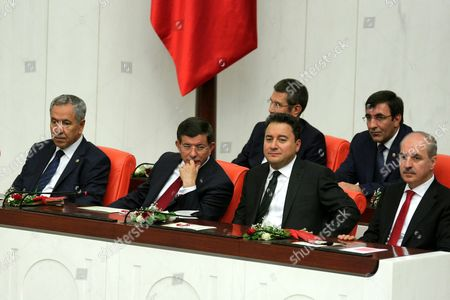Turkish Prime Minister Ahmet Davutoglu (3-r) and His Deputies Bulent Arinc (l) Ali Babacan (2-r) and Numan Kurtulmus (r) Attend the Opening Ceremony of the Turkish Parliament in Ankara Turkey 23 June 2015 Members of Turkey's Recently Elected Parliament Began Swearing Their Oaths of Allegiance on 23 June Even As Speculation Swirled About How a Deal Could Be Struck to Form a Coalition Government the Ruling Justice and Development Party (akp) Failed to Get Enough Seats to Govern Alone in Elections Earlier This Month the First Time It Has Been in This Situation Since It Swept to Power in 2002 That Means It Will Need to Strike a Deal with Another Party As the Prospect For a Minority Government Seems Remote Turkey Ankara